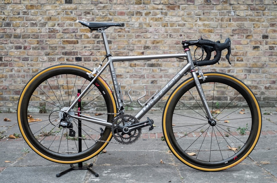 custom titanium road bicycle and fork with campagnolo record groupset zipp wheelset thomson elite stem and carbon handlebar