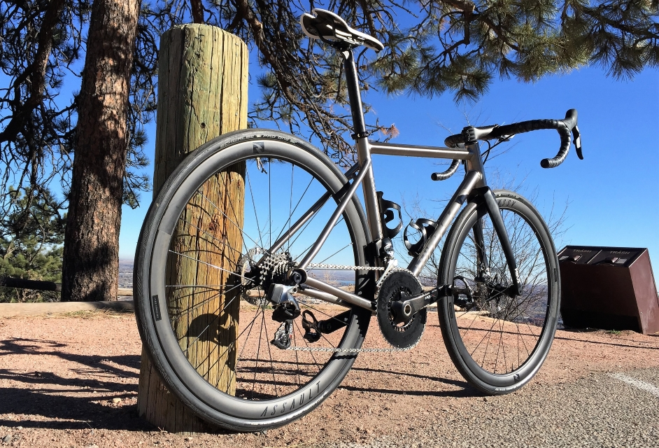 Custom titanium road disc bicycle Wittson illuminati with Sram Red eTap wireless groupset Rotor Qarbon Q-Rings Reynolds Assault Disc wheelset